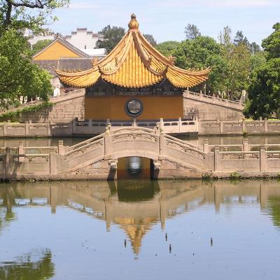 Chinese temple next to a body of water